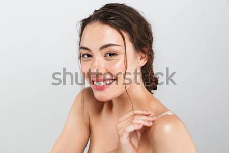 Close up beauty portrait of a laughing half naked woman Stock photo © deandrobot