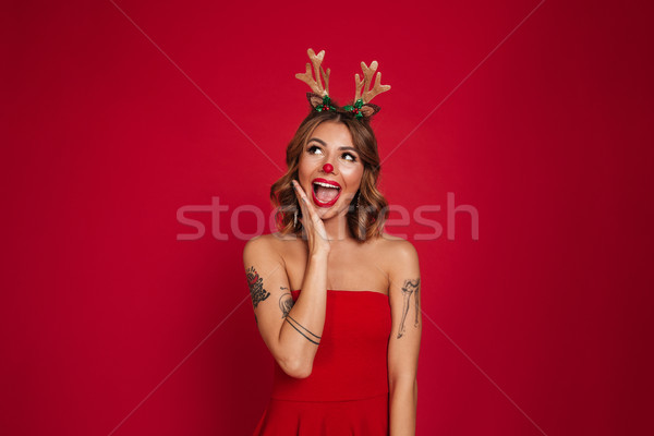 Portrait of a happy excited girl wearing christmas deer costume Stock photo © deandrobot
