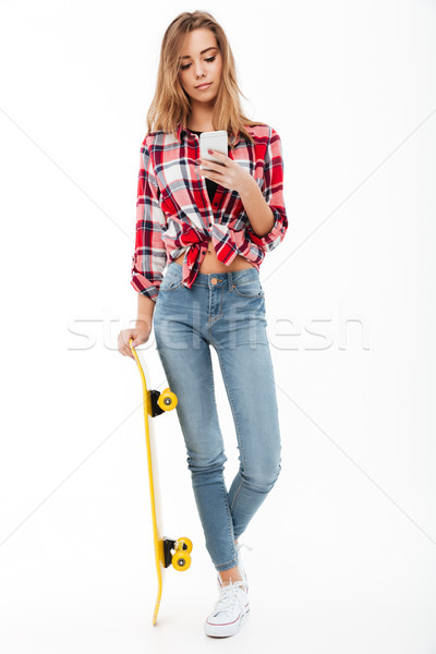 Full length portrait of a young pretty girl in plaid shirt Stock photo © deandrobot