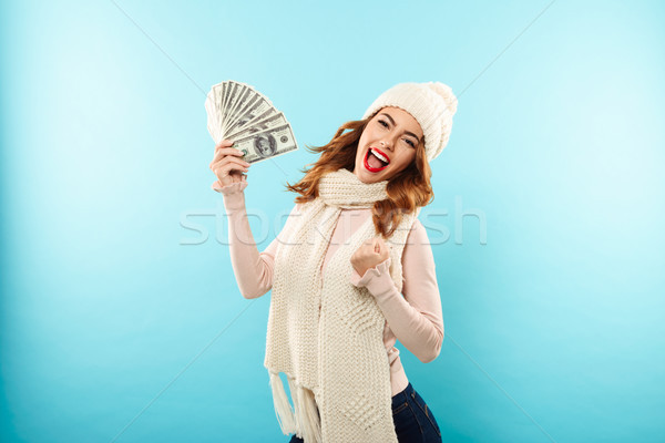 Portrait of a joyful pretty girl dressed in hat and scarf Stock photo © deandrobot
