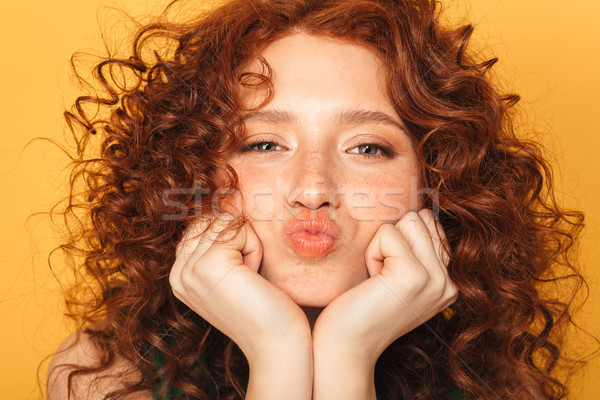 Close up portrait of a lovely curly redhead woman Stock photo © deandrobot