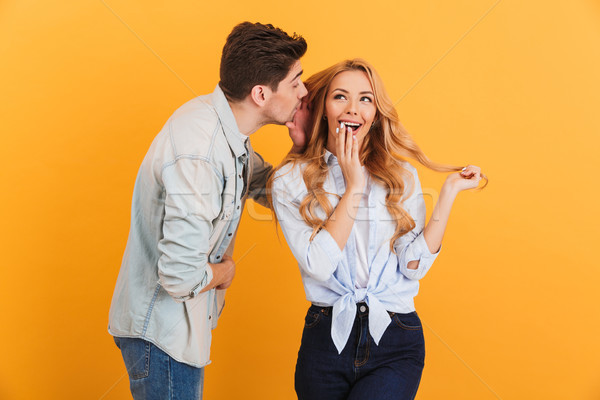 Portrait of brunette man whispering secret or interesting gossip Stock photo © deandrobot