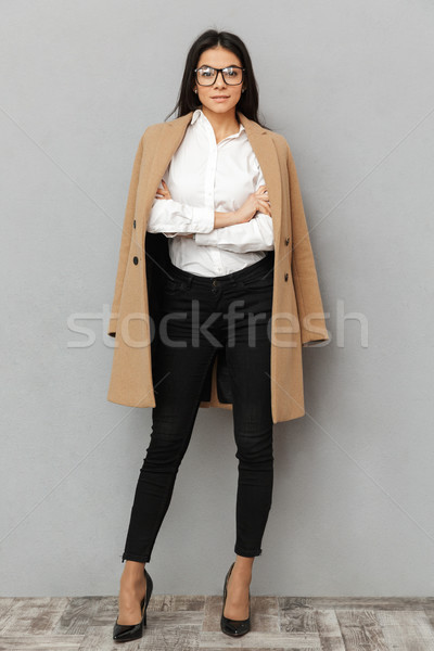 Full length image of elegant business woman in formal wear and b Stock photo © deandrobot