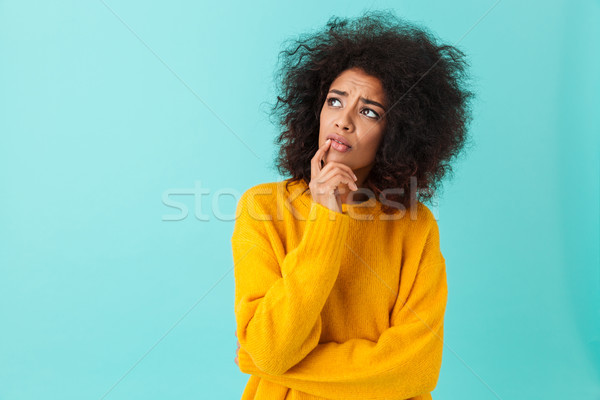 American woman in colorful shirt looking upward remembering or r Stock photo © deandrobot