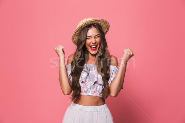 Portrait of joyful european woman 20s wearing straw hat screamin Stock photo © deandrobot
