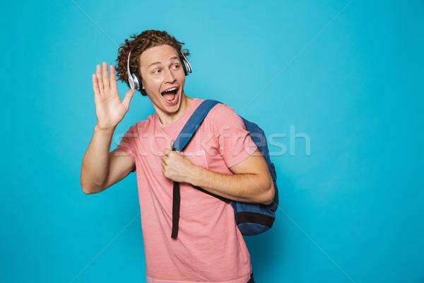 Portré kaukázusi fickó göndör haj visel hátizsák Stock fotó © deandrobot