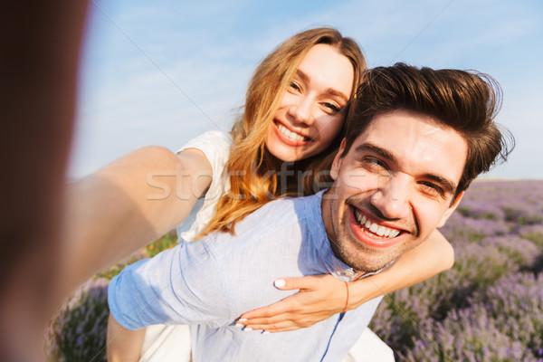 Feliz campo de lavanda piggyback flor Foto stock © deandrobot