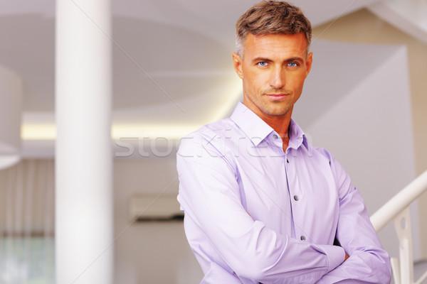портрет бизнесмен Постоянный зале здании свет Сток-фото © deandrobot