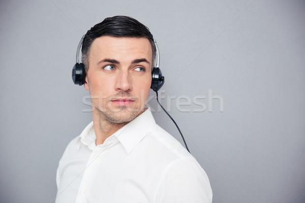 портрет задумчивый мужчины оператор серый Сток-фото © deandrobot