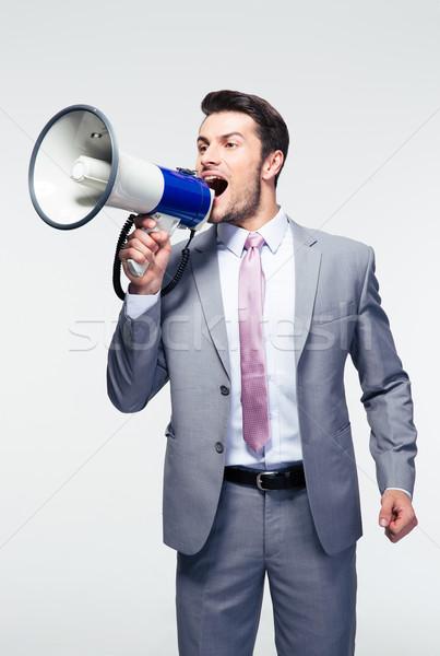 ビジネスマン ラウドスピーカー ハンサム グレー 背景 ストックフォト © deandrobot