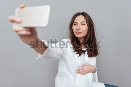 Businesswoman holding laptop and yawning  Stock photo © deandrobot