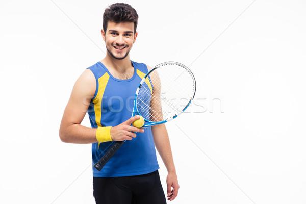 Derűs férfi tart teniszütő labda izolált Stock fotó © deandrobot