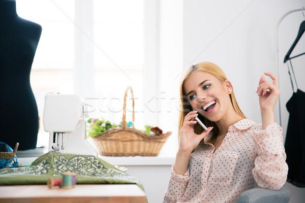 Female deisgner talking on the phone Stock photo © deandrobot