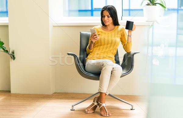 女性実業家 座って 事務椅子 幸せ 電話 カップ ストックフォト © deandrobot