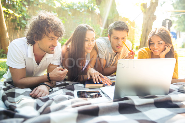 Students doing homework on the laptop together Stock photo © deandrobot
