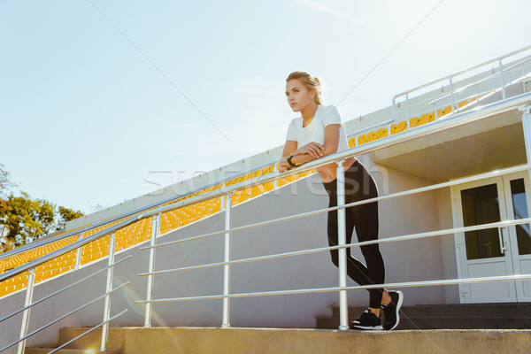 Woman in sports wear standing at stadium Stock photo © deandrobot