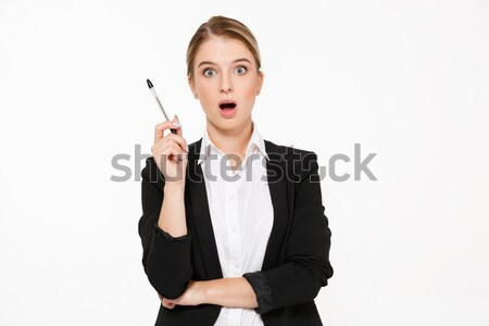 Happy woman in glasses pointing finger away  Stock photo © deandrobot