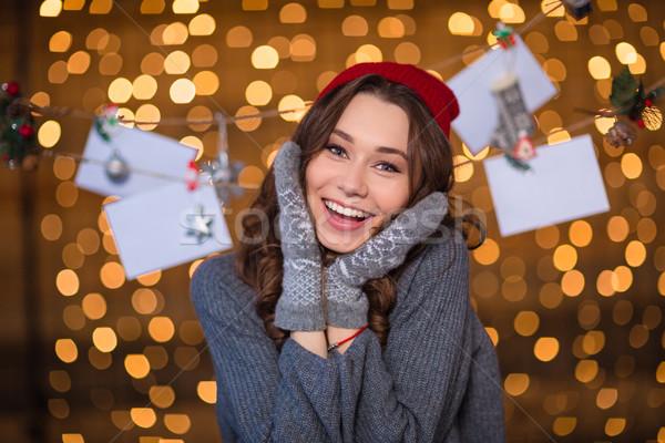 Derűs nő pózol kézzel készített dekoráció csillogó Stock fotó © deandrobot
