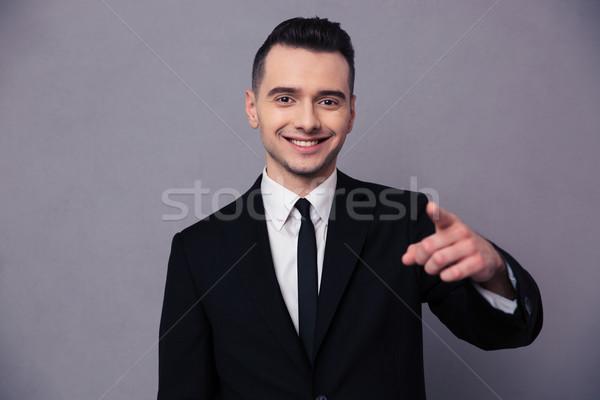Gülen işadamı işaret parmak kamera portre Stok fotoğraf © deandrobot