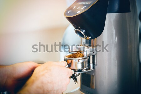 Barista grinding coffee Stock photo © deandrobot