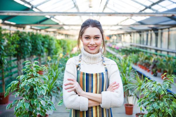 Belo feliz mulher jovem jardineiro colorido listrado Foto stock © deandrobot