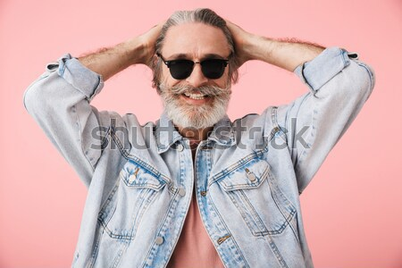 Pensive handsome bearded man scratching his head and thinking Stock photo © deandrobot