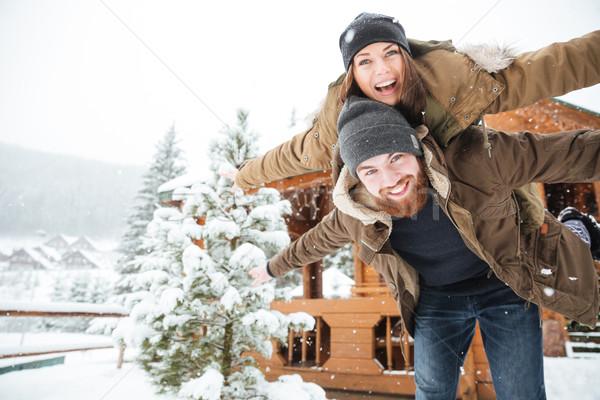 Mutlu adam kız arkadaş gülme kış yakışıklı Stok fotoğraf © deandrobot