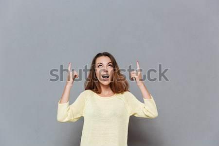 Mujer cubierto boca mano Foto stock © deandrobot