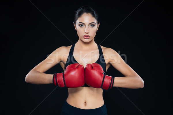 Young fitness girl with bloxing gloves looking at camera Stock photo © deandrobot