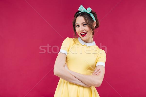 Pinup kız sarı elbise ayakta Stok fotoğraf © deandrobot