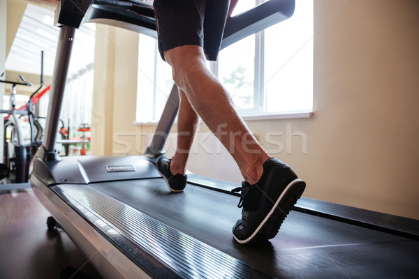 Lábak fiatal fitnessz férfi fut futópad Stock fotó © deandrobot
