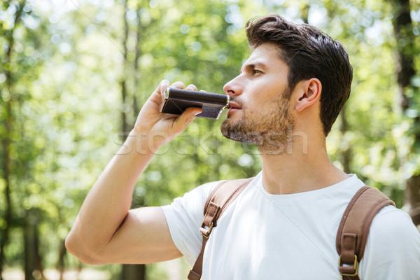 человека рюкзак Постоянный питьевой колба лес Сток-фото © deandrobot