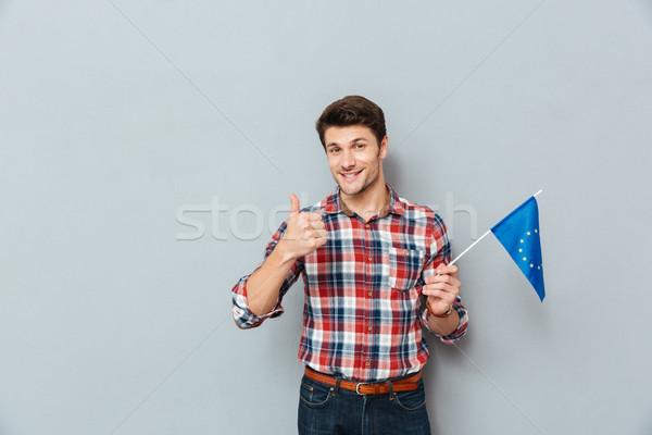 Man vlag Europa unie tonen Stockfoto © deandrobot