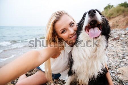 Alegre mujer toma perro playa cute Foto stock © deandrobot