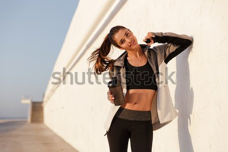 Attractive slim young woman cowgirl riding on horse outdoors Stock photo © deandrobot