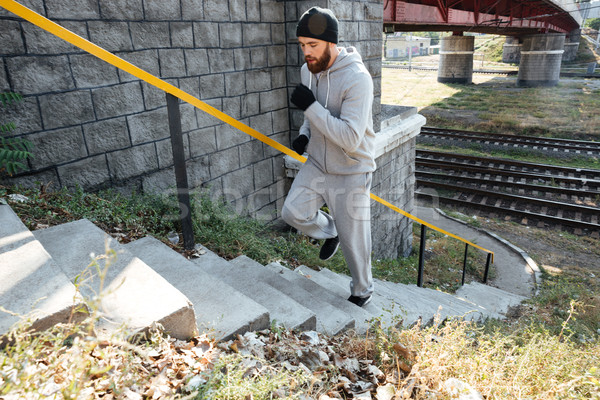 小さな フィットネス 男 を実行して アップ 階段 ストックフォト © deandrobot