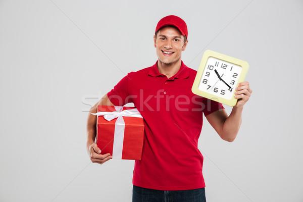 Futár óra ajándék stúdió néz kamera Stock fotó © deandrobot