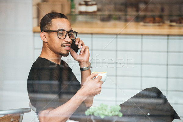Portrait of a young afro american man in eyeglasses Stock photo © deandrobot