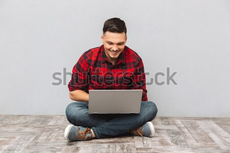 Man in shirt sitting on the floor with book Stock photo © deandrobot