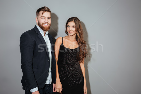Smiling ccouple in smart wear standing and looking at camera Stock photo © deandrobot