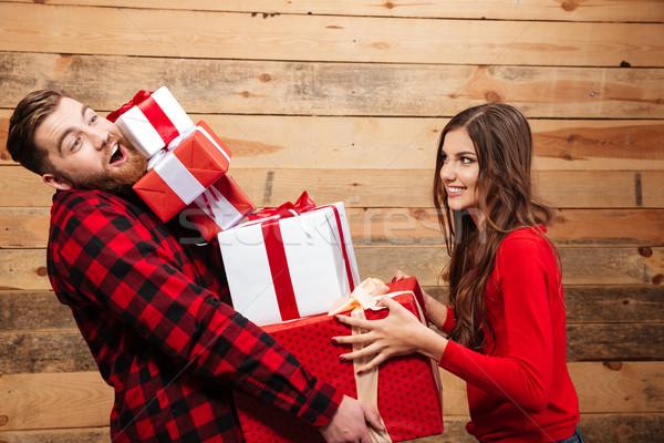 Boldog pár áll halom karácsony ajándék Stock fotó © deandrobot
