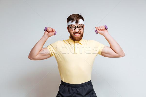 Homme nerd formation lumière haltères drôle Photo stock © deandrobot