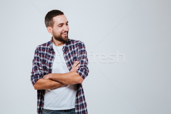 Smiling Bearded man in shirt with crossed arms Stock photo © deandrobot