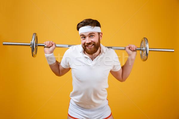 улыбаясь молодые спортсмен спорт штанга Сток-фото © deandrobot