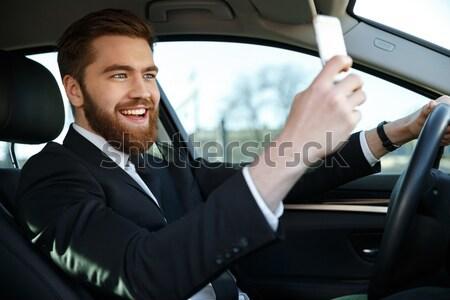 Vista lateral barbudo homem de negócios terno telefone Foto stock © deandrobot