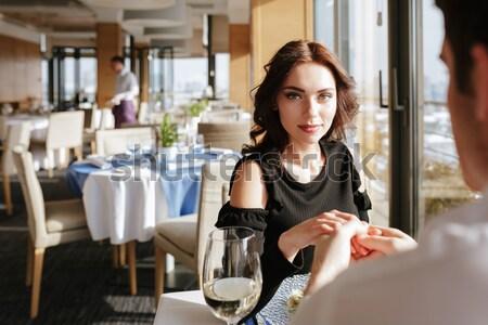 Csinos koncentrált nő áll étterem bent Stock fotó © deandrobot
