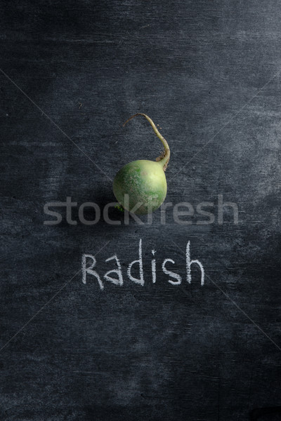 One radish over dark background Stock photo © deandrobot