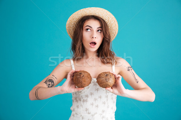 Portrait of a silly young girl in straw hat having fun Stock photo © deandrobot