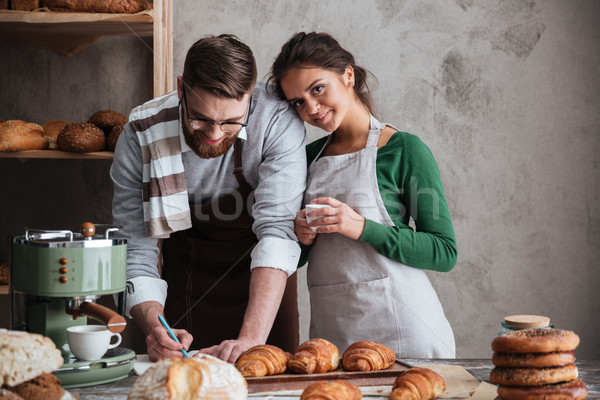 Potrait of cute family in kitchen Stock photo © deandrobot