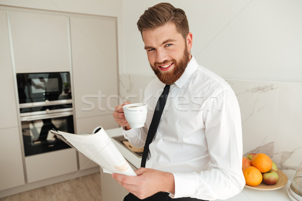 Pleased bearded business man drinking coffee Stock photo © deandrobot